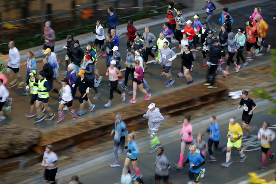 Photo - Runners make their way south on Robinson during the Oklahoma City Memorial Marathon in Oklahoma City, Sunday, April 30, 2017. Photo by Bryan Terry, The Oklahoman