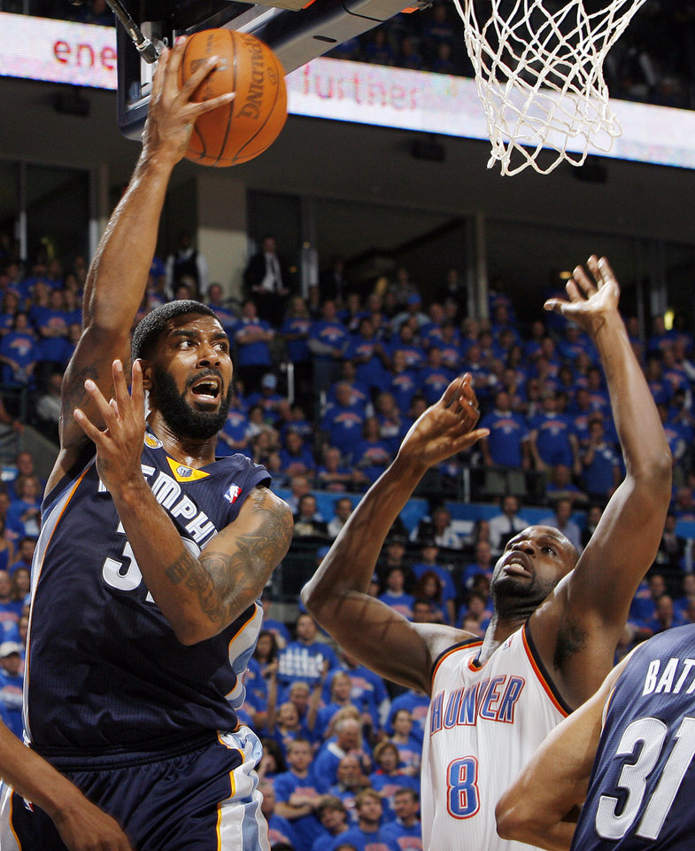 O.J. Mayo (32) of Memphis passes the ball over Nazr Mohammed (8) of Oklahoma City in the second half during game 7 of the NBA basketball Western Conference semifinals between the Memphis Grizzlies and the Oklahoma City Thunder at the OKC Arena in Oklahoma City, Sunday, May 15, 2011. The Thunder won, 105-90. Photo by Nate Billings, The Oklahoman