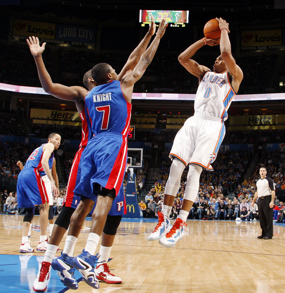 Oklahoma City's Russell Westbrook (0) shoots over the defense of Brandon Knight (7) and the Detroit Pistons during the NBA basketball game between the Detroit Pistons and Oklahoma City Thunder at the Chesapeake Energy Arena in Oklahoma City, Monday, Jan. 23, 2012. Photo by Nate Billings, The Oklahoman