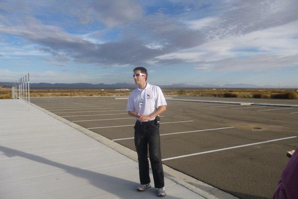 Photo - Aaron Prescott, business operations manager for Spaceport America, stands on the 12,000-feet-long