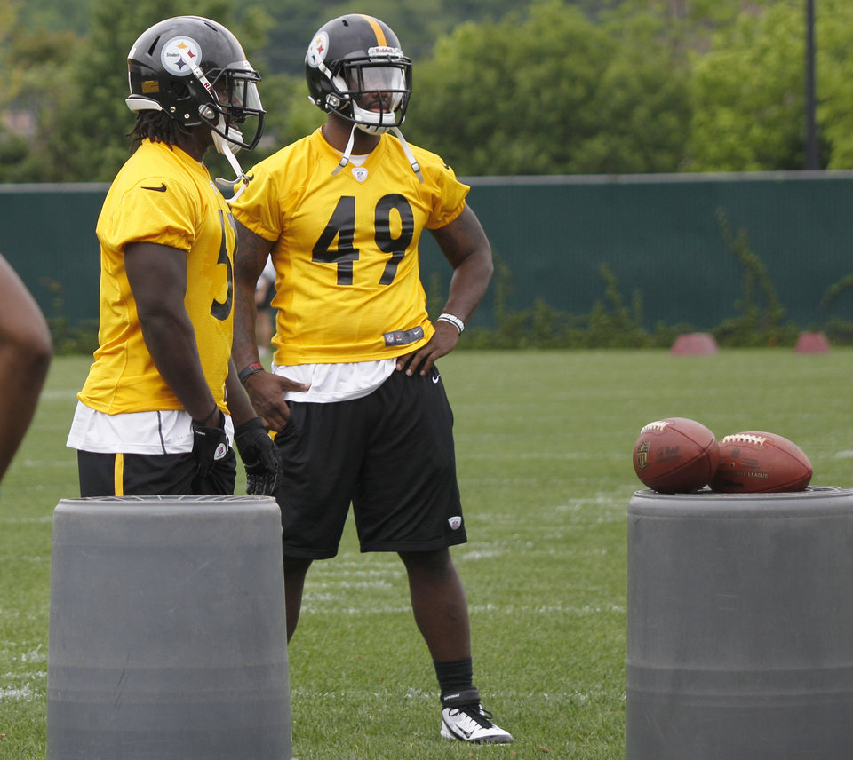 Photo -   Pittsburgh Steelers free agent linebacker, Brandon Lindsey (49) out of Pittsburgh, stands with third round draft pick, linebacker Sean Spence, out of Miami, during the NFL football team's rookie minicamp at their facility in Pittsburgh on Saturday, May 5, 2012. Lindsey is hoping to catch on with the Steelers after going undrafted following a stellar career at Pittsburgh. Lindsey had 8.5 sacks last season for the Panthers. (AP Photo/Keith Srakocic)