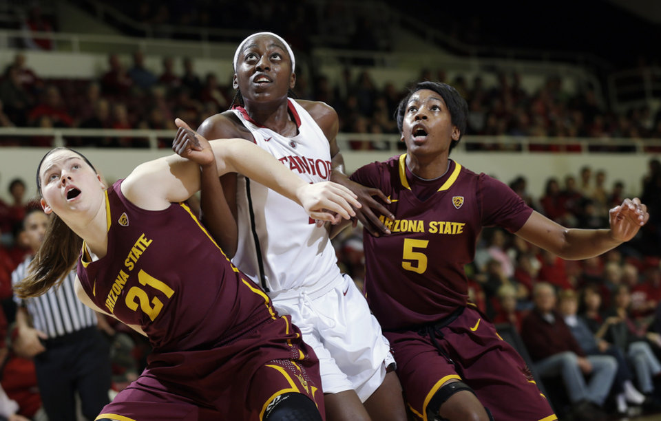 Photo - Stanford forward Chiney Ogwumike, center, fights for position under the basket against Arizona State forward Sophie Brunner (21) and guard Deja Mann (5) during the first half of an NCAA college basketball game Friday, Feb. 14, 2014, in Stanford, Calif. (AP Photo/Marcio Jose Sanchez)