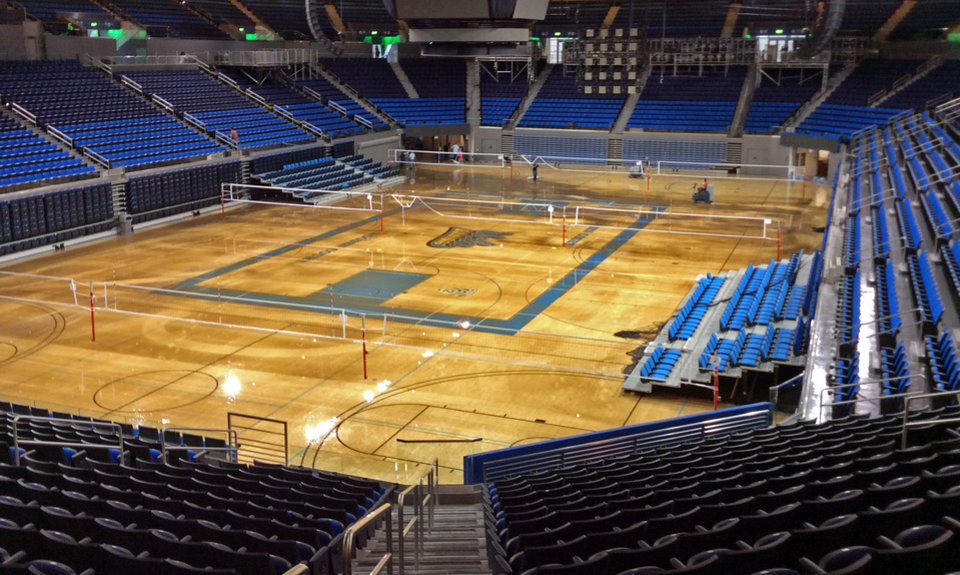 Photo - Water covers the playing floor of Pauley Pavilion, home of UCLA basketball, after a 30-inch water main burst on nearby Sunset Boulevard on the campus in the Westwood district of Los Angeles Tuesday, July 29, 2014. (AP Photo/Matt Hamilton)