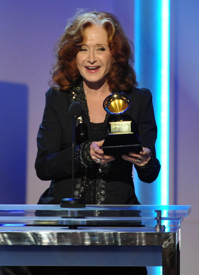 "Bonnie Raitt accepts the award for best Americana album for ""Slipstream"" during the pre-telecast at the 55th annual Grammy Awards on Sunday, Feb. 10, 2013, in Los Angeles. (Photo by John Shearer/Invision/AP)"