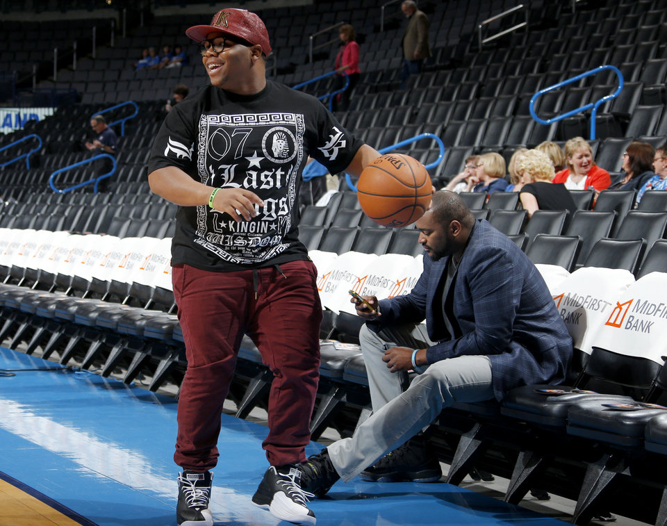 Ray Westbrook dribbles a basketball court side before an NBA basketball game between the Oklahoma City Thunder and the New Orleans Pelicans at Chesapeake Energy Arena in Oklahoma City, Friday, April 11, 2014. Oklahoma City won 116-94. Photo by Bryan Terry, The Oklahoman