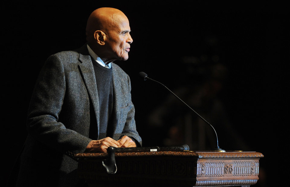 Photo - Activist and entertainer Harry Belafonte gives the keynote address for the Rev. Dr. Martin Luther King Jr. Symposium at Hill Auditorium on the University of Michigan campus in Ann Arbor, Mich., for Martin Luther King Jr. Day, on Monday, Jan. 20, 2014. (AP Photo/The Ann Arbor News, Melanie Maxwell)