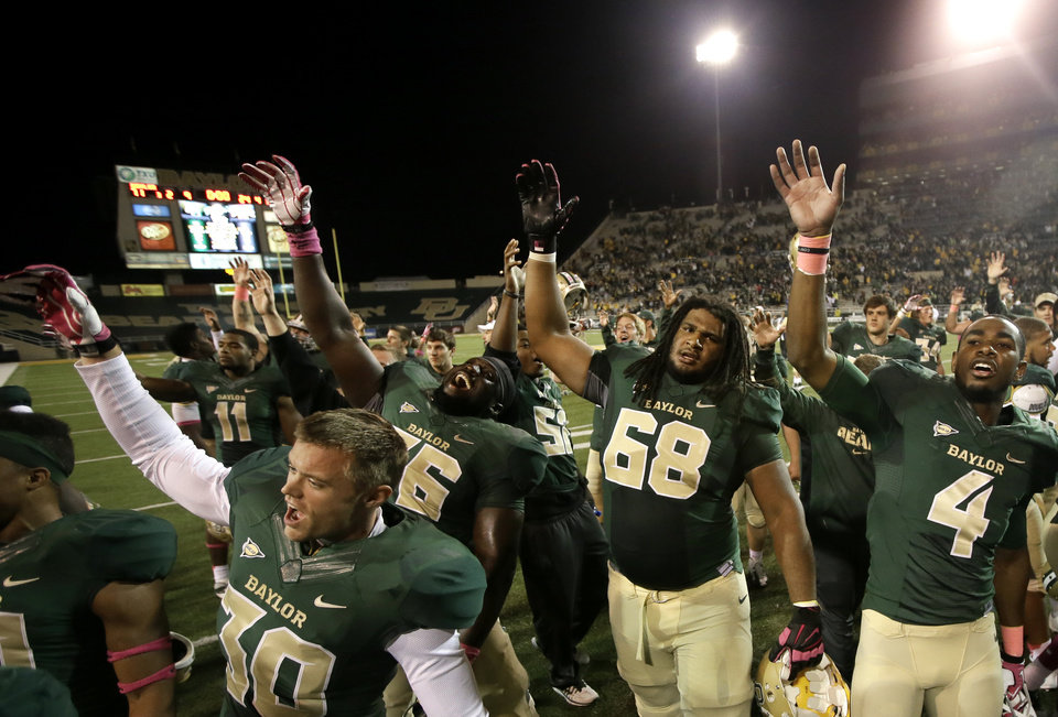 Baylor\'s Cody Wetsel, front left, Jason Osei, Cyril Richardson (68) and Jay Lee (4) celebrate on the field following an NCAA college football game against Iowa State, Saturday, Oct. 19, 2013, in Waco, Texas. Baylor won 71-7. (AP Photo/Tony Gutierrez)