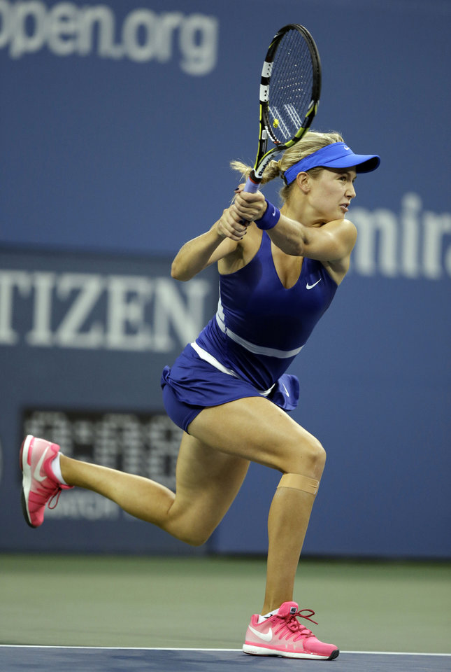 Photo - Eugenie Bouchard, of Canada, returns a shot to Barbora Zahlavova Strycova, of the Czech Republic, during the third round of the 2014 U.S. Open tennis tournament Saturday, Aug. 30, 2014, in New York. (AP Photo/Darron Cummings)
