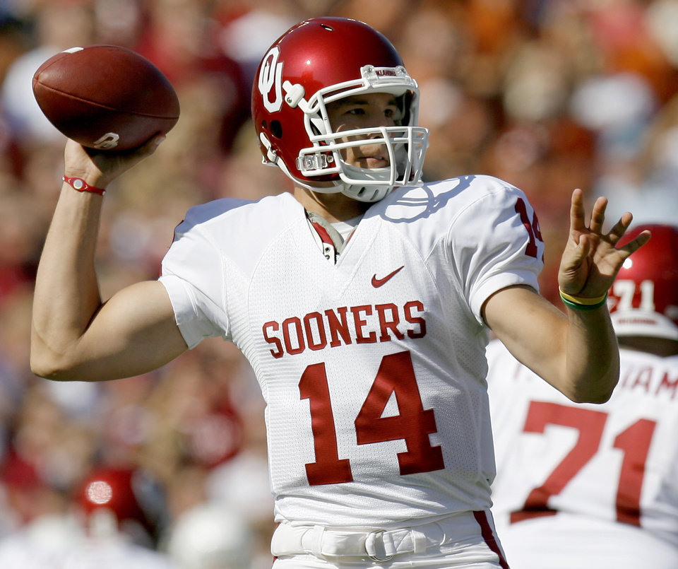 Photo - OU's Sam Bradford throws the ball during the Red River Rivalry college football game between the University of Oklahoma Sooners (OU) and the University of Texas Longhorns (UT) at the Cotton Bowl in Dallas, Texas, Saturday, Oct. 17, 2009. Photo by Bryan Terry, The Oklahoman