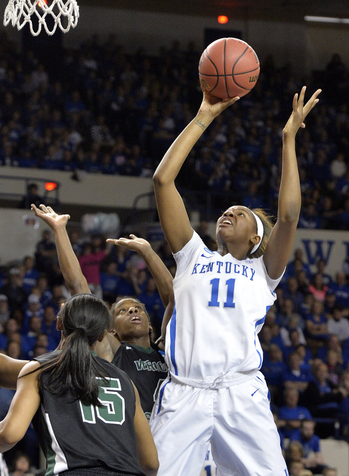 Photo - Kentucky's DeNesha Stallworth, right, shoots over Wright State's Symone Denham, left, and Kim Demmings during the first half of a first-round game in the NCAA women's college basketball tournament in Lexington, Ky., Saturday, March 22, 2014. Kentucky defeated Wright State 106-60. (AP Photo/Timothy D. Easley)
