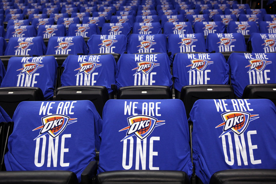 Photo - Shirts sit on chairs before the NBA basketball playoff game between the Oklahoma City Thunder and the Dallas Mavericks  at Chesapeake Energy Arena in Oklahoma City, Saturday, April 28, 2012. Photo by Sarah Phipps, The Oklahoman.