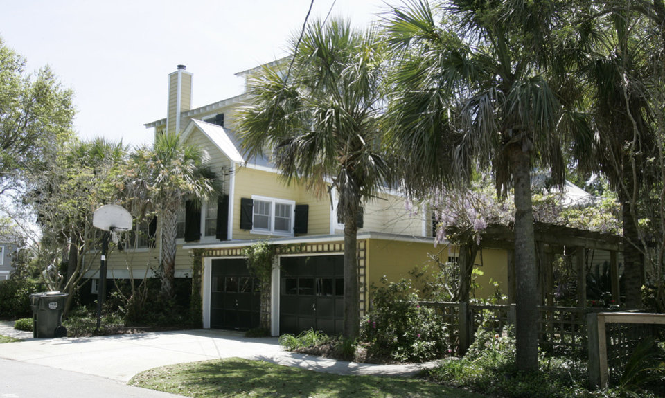 Photo - This is a side view of the home of Jenny Sanford taken Wednesday, April 17, 2013, on Sullivan's Island, S.C., where she says her ex-husband former Gov. Mark Sanford trespassed in February of this year. Sanford said that he was visiting his son to watch the Super Bowl. (AP Photo/Mary Ann Chastain)