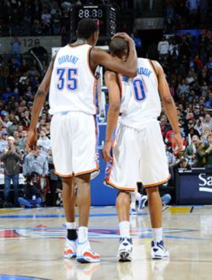 OKLAHOMA CITY - DECEMBER 19: Kevin Durant #35 and Russell Westbrook #0 give each other pats on the back seconds before a win against the Toronto Raptors at the Ford Center on December 19, 2008 in Oklahoma City, Oklahoma. NOTE TO USER: User expressly acknowledges and agrees that, by downloading and/or using this Photograph, user is consenting to the terms and conditions of the Getty Images License Agreement. Mandatory Copyright Notice: Copyright 2008 NBAE (Photo by Larry W. Smith/NBAE via Getty Images) *** Local Caption *** Kevin Durant;Russell Westbrook