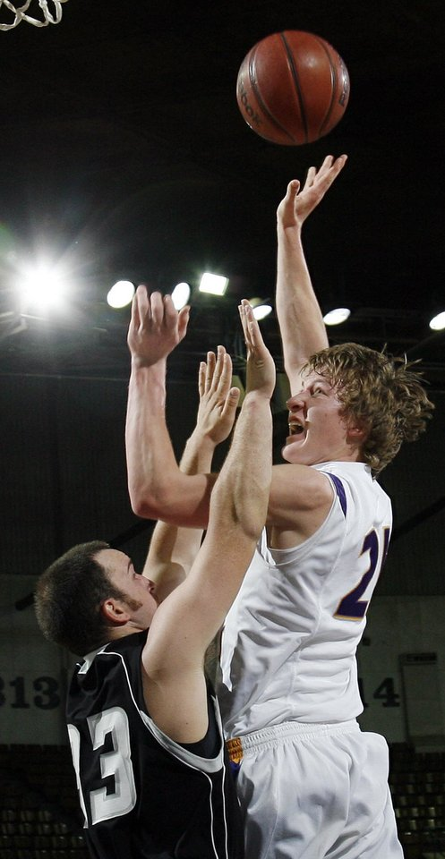 Okarche\'s Sam Grellner (21) shoots over Wright City\'s Rusty Stuart (33) sduring a quarterfinal game between Wright City and Okarche in the Class A boys high school basketball state tournament at State Fair Arena in Oklahoma City, Thursday, March 1, 2012. Photo by Nate Billings, The Oklahoman