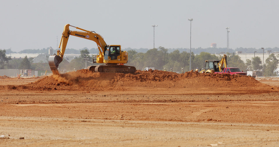 Photo -  Dirt work is ongoing at the construction site of Hobby Lobby's new warehouse at 6900 SW 29.   PAUL B. SOUTHERLAND -