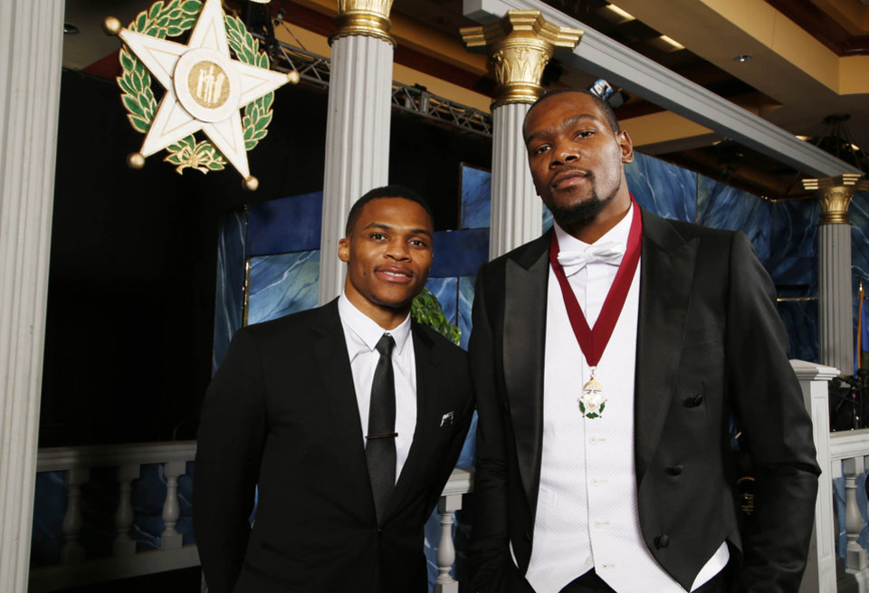 Photo - Oklahoma City Thunder basketball players Russell Westbrook, left, and Kevin Durant pose for a photo before the 8th annual Oklahoma Hall of Fame banquet and induction ceremony at the Renaissance Hotel in Tulsa. Durant was an inductee, and Westbrook was his presenter. (Photo by James Gibbard/Tulsa World)