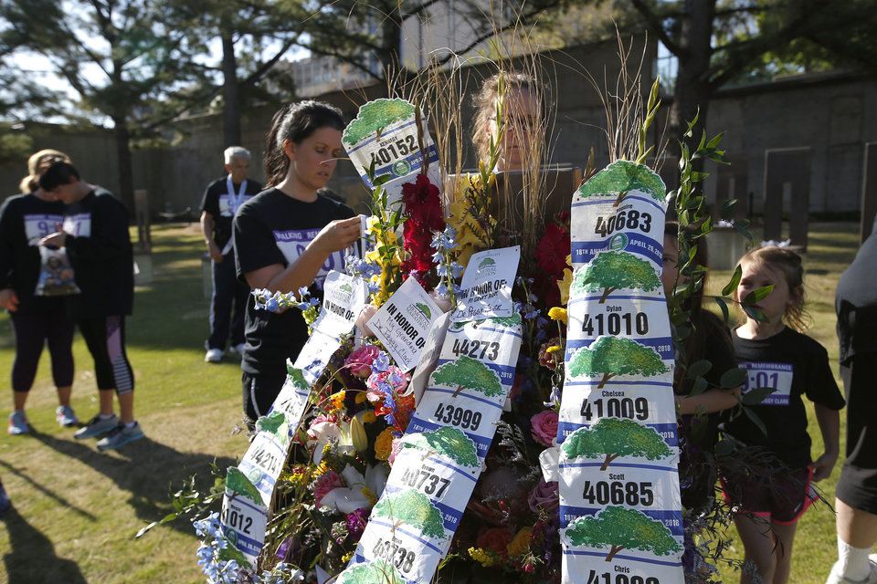 Photo - The family of Dr. Peggy Clark decorate her memorial chair following the Oklahoma City Marathon in Oklahoma City,  Sunday, April 29, 2018. Photo by Sarah Phipps, The Oklahoman