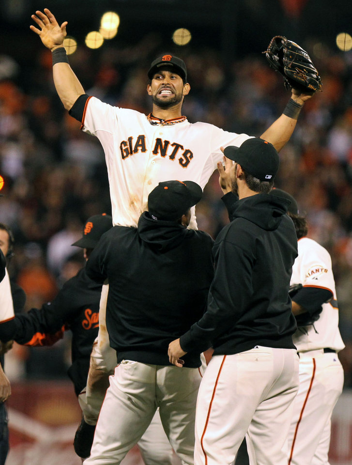 Photo -   San Francisco Giants' Angel Pagan is lifted by his teammates as the Giants celebrate their 8-4 win over the San Diego Padres in a baseball game Saturday, Sept. 22, 2012, in San Francisco. The Giants won 8-4, and captured the NL West title. (AP Photo/San Francisco Chronicle, Lance Iversen) MANDATORY CREDIT MAGS OUT NO SALES TV OUT