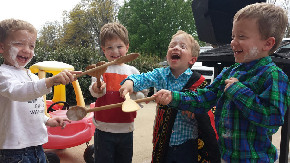 Photo - From left: Cooper, Logan, Allen and Wyatt Newby play with wooden spoons and flour.  Photo provided