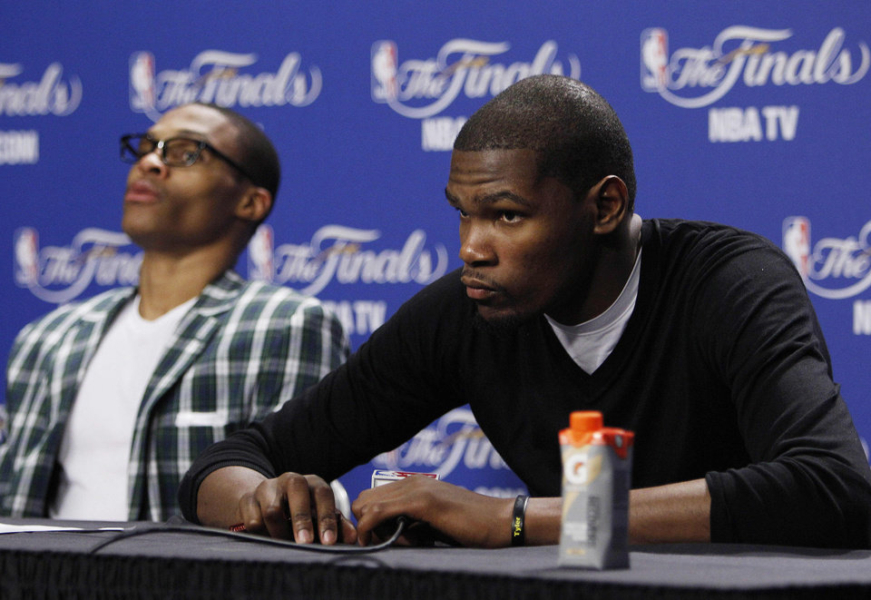 Oklahoma City Thunder point guard Russell Westbrook, left, and small forward Kevin Durant listen to a question during a news conference after Game 4 of the NBA finals basketball series against the Miami Heat, Wednesday, June 20, 2012, in Miami. The Heat won 104-98. (AP Photo/Lynne Sladky)  ORG XMIT: NBA188