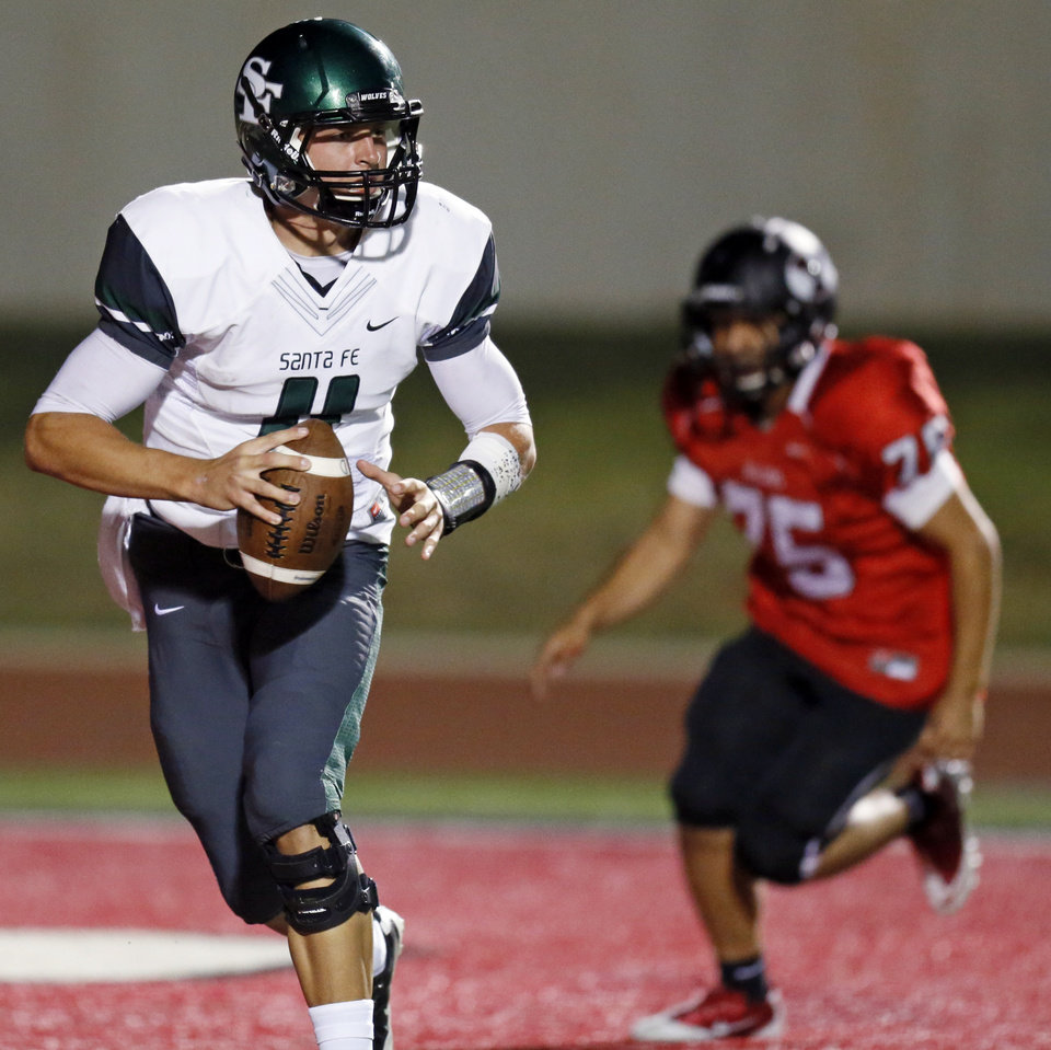 Edmond Santa Fe quarterback Justice Hansen (11) looks for a receiverduring a high school football game between Yukon and Edmond Santa Fe in Yukon, Okla., Friday, Sept. 7, 2012. Photo by Nate Billings, The Oklahoman