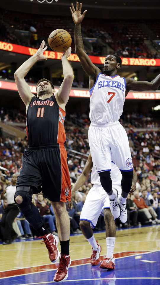 Toronto Raptors' Linas Kleiza (11), of Lithuania, shoots as Philadelphia 76ers' Royal Ivey (7) defends in the first half of an NBA basketball game, Tuesday, Nov. 20, 2012, in Philadelphia. (AP Photo/Matt Slocum)