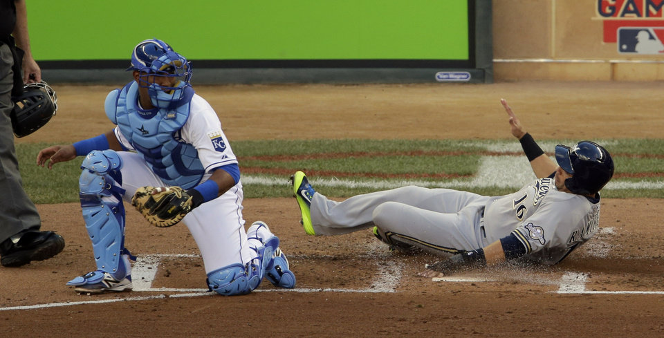 Photo - National League's Aramis Ramirez, of the Milwaukee Brewers, scores in front of American League catcher Salvador Perez, left, during the second inning of the MLB All-Star baseball game, Tuesday, July 15, 2014, in Minneapolis. (AP Photo/Paul Sancya)