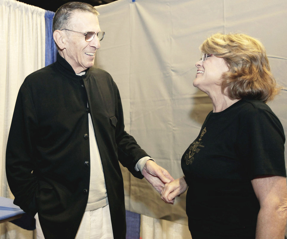 Leonard Nimoy visits with fan Susan Hendrex of  Catoosa Saturday at the Trek Expo.  PHOTO BY MIKE SIMONS, TULSA WORLD