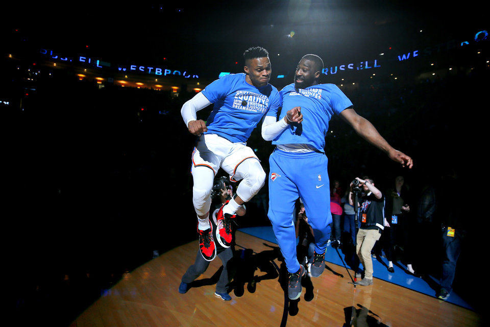 Photo - Raymond Felton (2), right, greets Russell Westbrook Russell during player introductions prior to an NBA basketball game between the Oklahoma City Thunder and the Memphis Grizzlies at Chesapeake Energy Arena in Oklahoma City, Thursday, Feb. 7, 2019. Photo by Bryan Terry, The Oklahoman