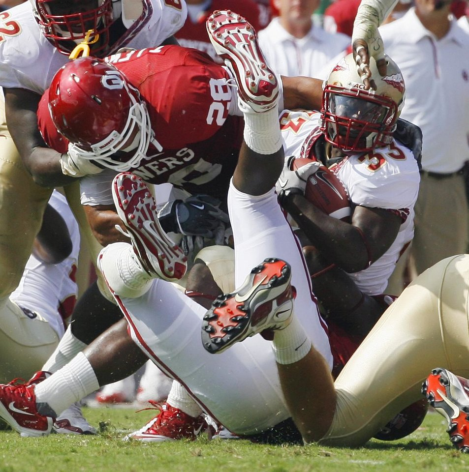 Ty Jones (33) is stopped by Travis Lewis (28) during the first half of the college football game between the University of Oklahoma Sooners (OU) and Florida State University Seminoles (FSU) at the Gaylord Family-Oklahoma Memorial Stadium on Saturday, Sept. 11 2010, in Norman, Okla. Photo by Steve Sisney, The Oklahoman