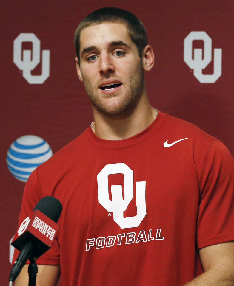 Photo - Oklahoma quarterback Trevor Knight answers a question during Media Day in Norman, Okla., Saturday, Aug. 2, 2014. Knight was MVP of the Sugar Bowl last season, but he didn't play that well consistently last year. With high expectations for the Sooners this year, the pressure is on for the sophomore to elevate his game regularly. (AP Photo/Sue Ogrocki)