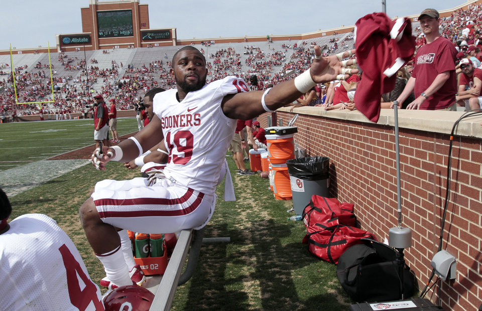 Photo - Eric Striker (19) throws a jersey after signing if for a fan during the Spring College Football Game of the University of Oklahoma Sooners (OU) at Gaylord Family-Oklahoma Memorial Stadium in Norman, Okla., on Saturday, April 12, 2014.  Photo by Steve Sisney, The Oklahoman