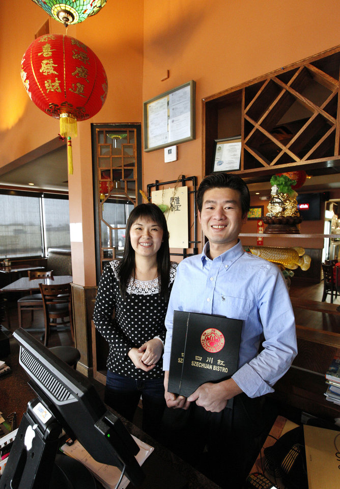 Owners Sophia and Leo Chen at Szechuan Bistro, 1010 W Memorial Road, in Oklahoma City. <strong>PAUL B. SOUTHERLAND - THE OKLAHOMAN</strong>