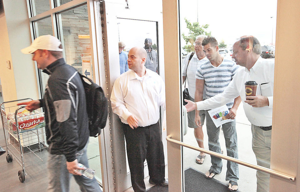 Photo - Customers enter the store after waiting in line for the new iPhones at the AT&T store on Memorial and Penn, September 20, 2013.  Photo by David McDaniel, The Oklahoman