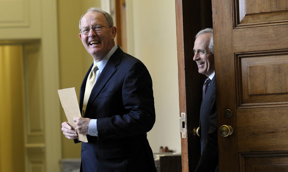 Photo - Sen. Lamar Alexander, R-Tenn., left, and Sen Bob Corker, R-Tenn., walk out of a closed-door meeting of Senate Republicans on Capitol Hill in Washington, Wednesday, Oct. 9, 2013. President Barack Obama is making plans to talk with Republican lawmakers at the White House in the coming days as pressure builds on both sides to resolve their deadlock over the federal debt limit and the partial government shutdown.  (AP Photo/Susan Walsh)