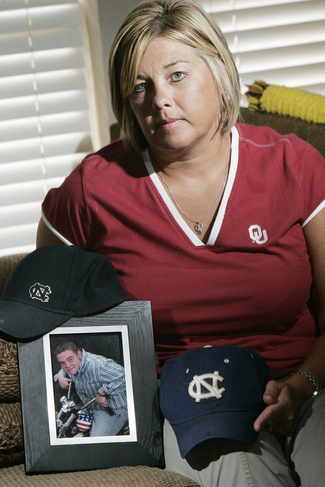 Photo - DRUG OVERDOSE: Angie with things and a photo of her son Michael who overdosed Wed. Aug. 19, 2009. Photo by Jaconna Aguirre, The Oklahoman. ORG XMIT: KOD
