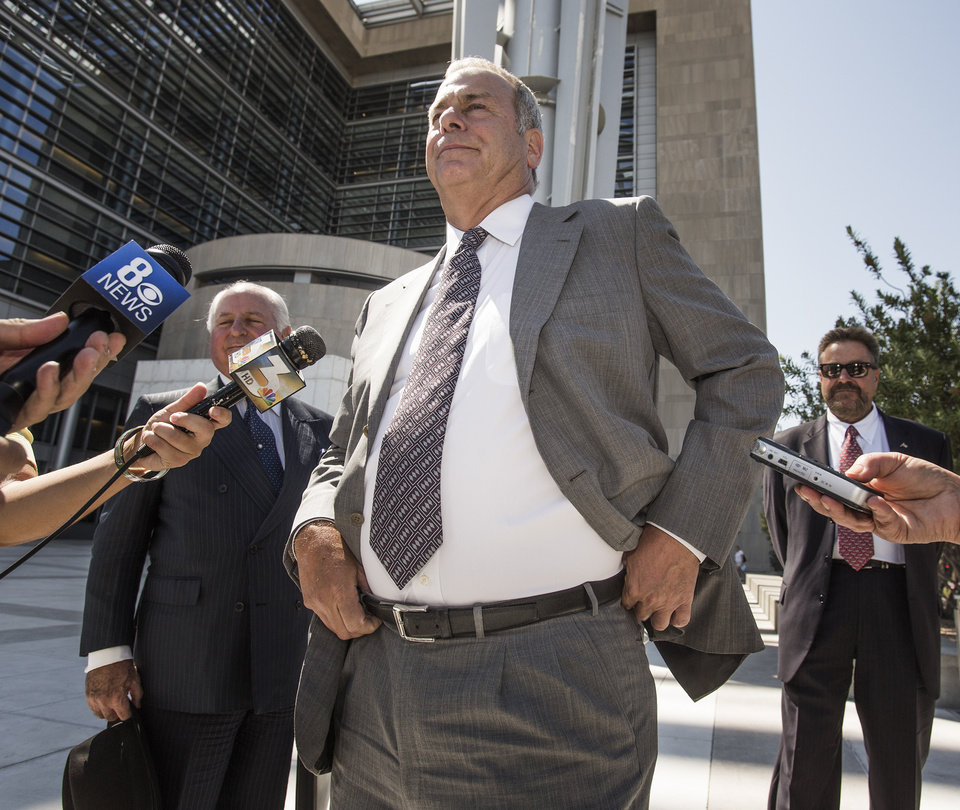 Photo - Las Vegas Sun Publisher and Editor Brian Greenspun leaves the Lloyd D. George Federal Courthouse after an injunction hearing on Friday, Sept. 6, 2013, in Las Vegas.  U.S. District Judge James Mahan said he won't stop the company that owns the Las Vegas Review-Journal from trying to buy out the family publishers of the rival Las Vegas Sun. (AP Photo/Las Vegas Review-Journal, Jeff Scheid) LOCAL TV OUT; LOCAL INTERNET OUT; LAS VEGAS SUN OUT