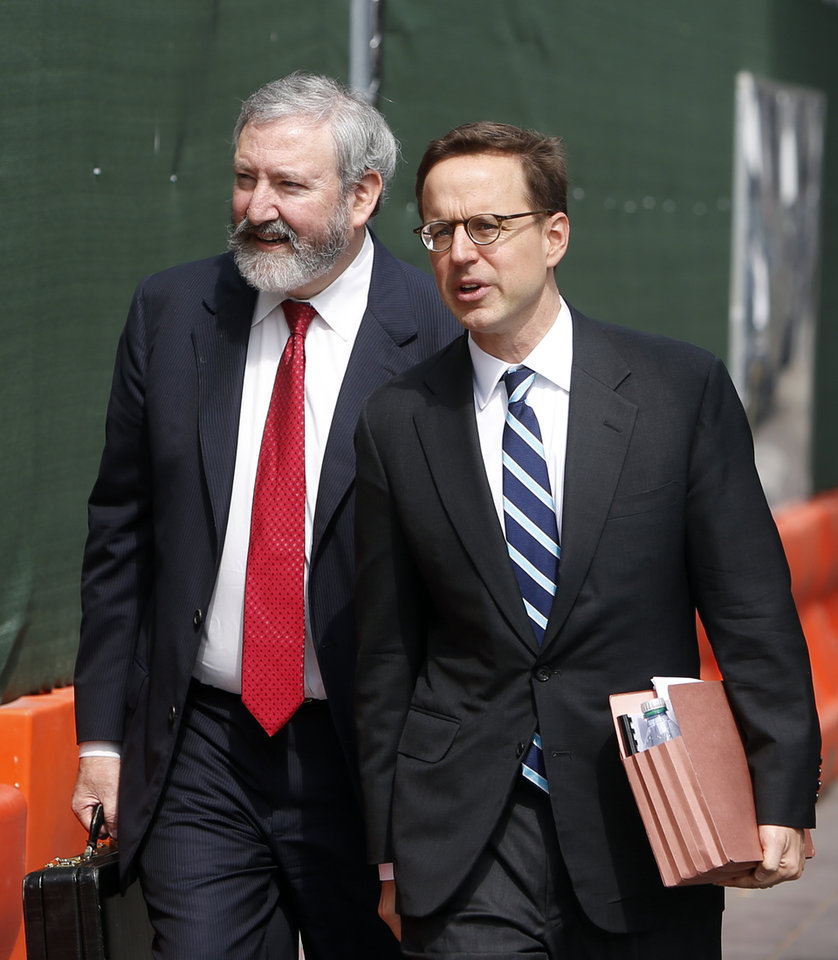 Photo - Jonathan Blackman, left, and Carmine Boccuzzi, lawyers representing Argentina, arrive at federal court for a hearing regarding the country's request to extend deadlines to repay a $1.65 billion debt to U.S. hedge funds, Friday, June 27, 2014, in New York.   Judge Thomas P. Griesa has ordered a U.S. bank to return a $539 million payment from Argentina, saying it was illegal to make. The order by the judge came Friday, three days before Argentina faces default if it fails to pay $832 million to the majority of its debt holders.(AP Photo/Jason DeCrow)
