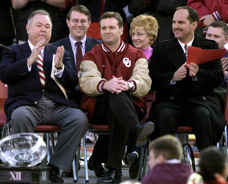 Photo - OU President David Boren, college football head coach Bob Stoops and athletic director Joe Castiglione on stage during the OU rally. OKLAHOMAN ARCHIVE PHOTO