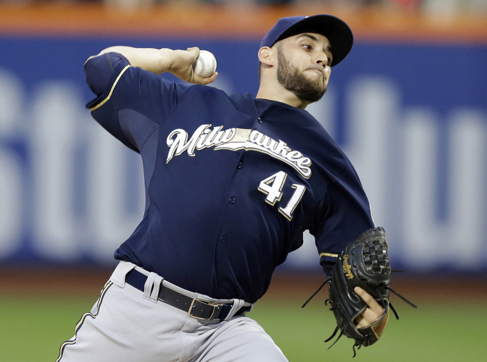 Photo - Milwaukee Brewers' Marco Estrada delivers a pitch during the first inning of a baseball game against the New York Mets, Tuesday, June 10, 2014, in New York.  (AP Photo/Frank Franklin II)