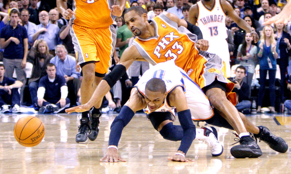 Oklahoma City's Russell Westbrook (0) and Phoenix's Grant Hill (3) scramble fof a loose ball during the NBA game between the Oklahoma City Thunder and the Phoenix Suns, Sunday, March 6, 2011, the Oklahoma City Arena. Photo by Sarah Phipps, The Oklahoman.