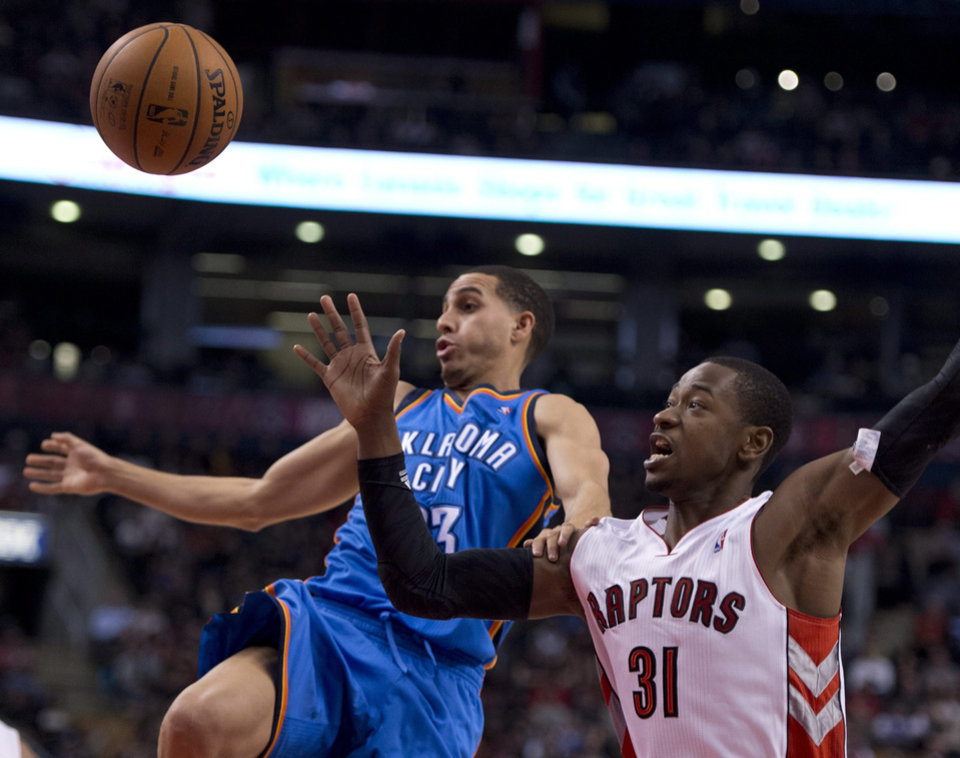 Toronto Raptors guard Terrence Ross (31) knocks the ball loose as he fouls Oklahoma City Thunder guard Kevin Martin during first-half NBA basketball game action in Toronto, Sunday, Jan.6, 2013. (AP Photo/The Canadian Press, Frank Gunn)