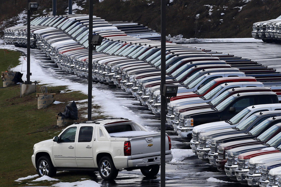 Photo - In this Wednesday, Jan. 9, 2013 photo, Chevy trucks line the lot of a dealer in Murrysville, Pa. Ford, Chrysler and General Motors all reported double-digit gains for January as last year's momentum in U.S. auto sales continued into 2013, according to reports Friday, Feb. 1, 2013. AP Photo  Gene J. Puskar - AP