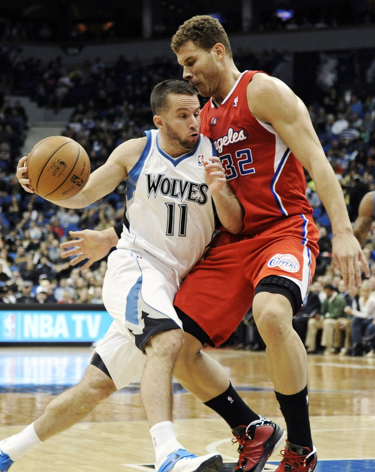 Photo - Minnesota Timberwolves' Jose Juan Barea (11) drives against Los Angeles Clippers' Blake Griffin (32) during the first half of an NBA basketball game, Thursday, Jan. 17, 2013, in Minneapolis. (AP Photo/Jim Mone)