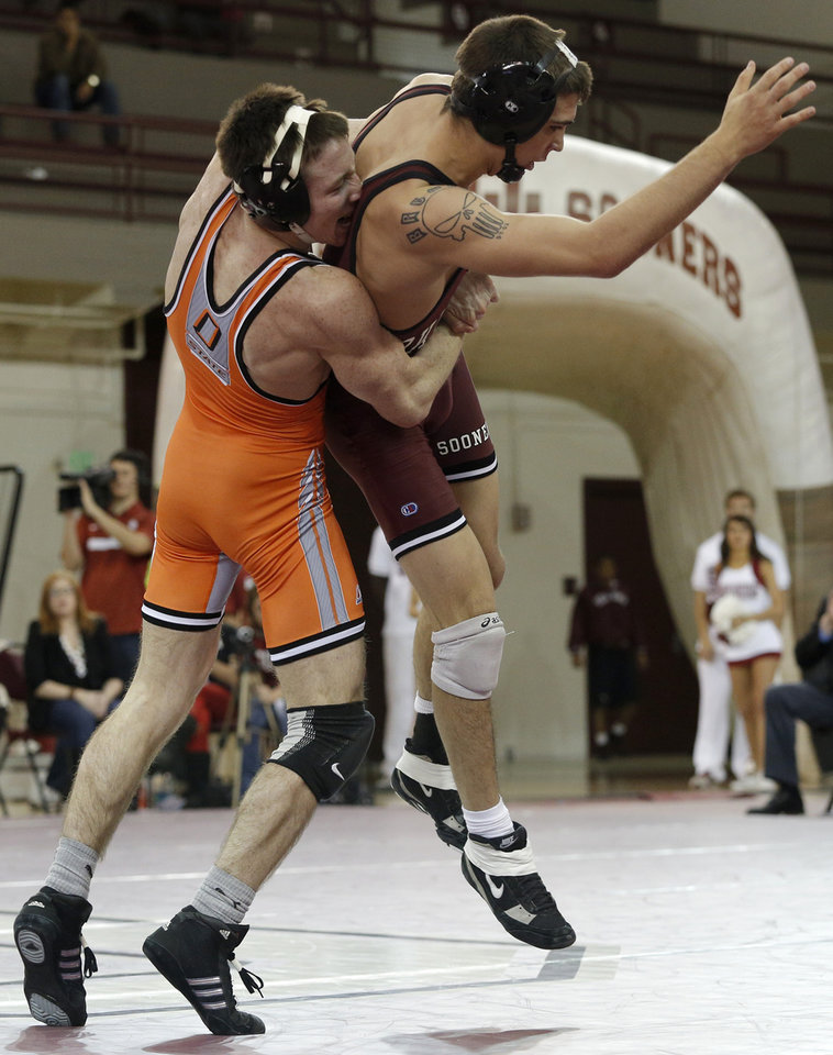OU's Cody Brewer wrestles OSU's Jon Morrison during the wrestling match between Oklahoma University and Oklahoma State University at McCasland Field House in Norman, Okla.,Sunday, Dec. 9, 2012.  Photo by Garett Fisbeck, For The Oklahoman