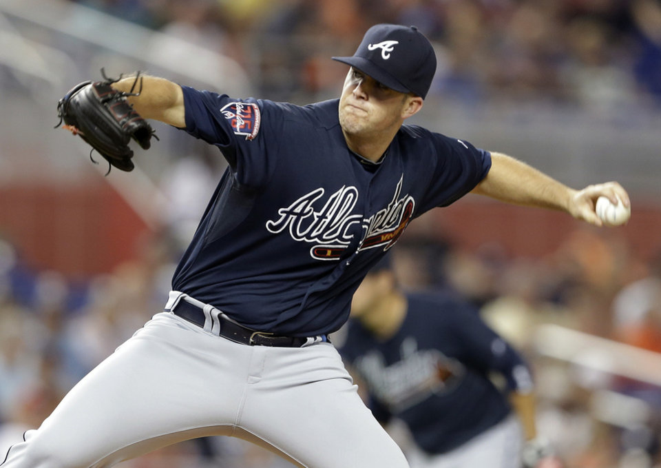 Photo - Atlanta Braves starting pitcher Alex Wood throws during the first inning of a baseball game against the Miami Marlins, Tuesday, April 29, 2014, in Miami. (AP Photo)