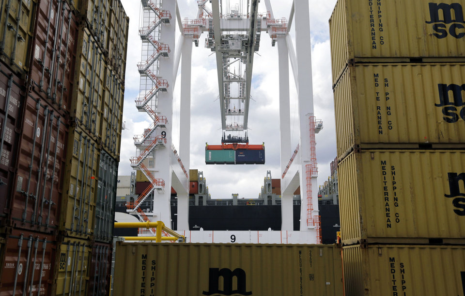 In this March 1 photo, a crane removes a container from a ship at the Port of Baltimore\'s Seagirt Marine Terminal in Baltimore. The government issues its third and final estimate of economic growth in the January-March quarter, Wednesday. AP Photo/Patrick Semansky, File Patrick Semansky - AP