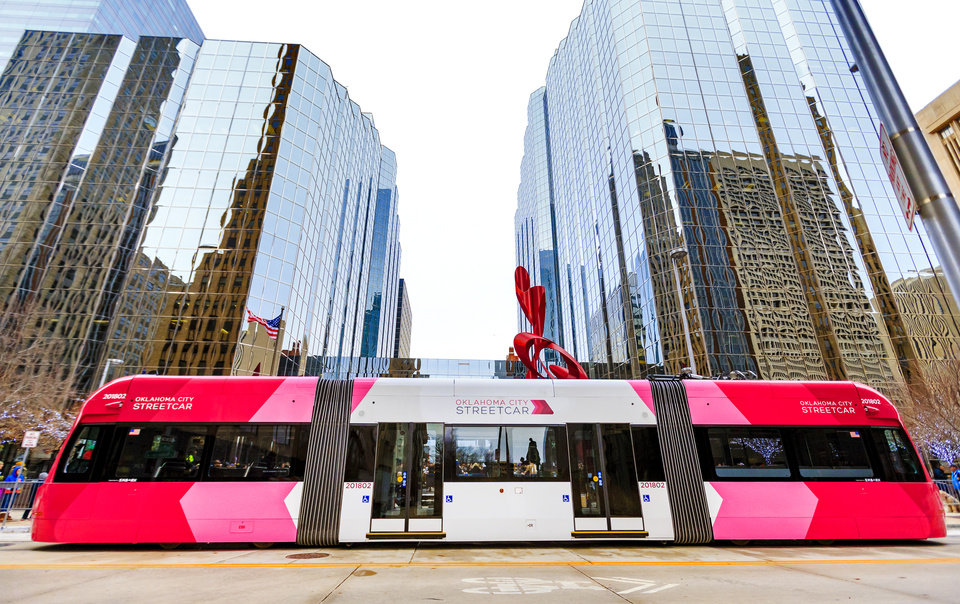 Photo - The streetcar parked outside of Leadership Square to celebrate the grand opening ceremony of the Oklahoma City streetcar system in downtown Oklahoma City, Okla. on Friday, Dec. 14, 2018. Photo by Chris Landsberger, The Oklahoman