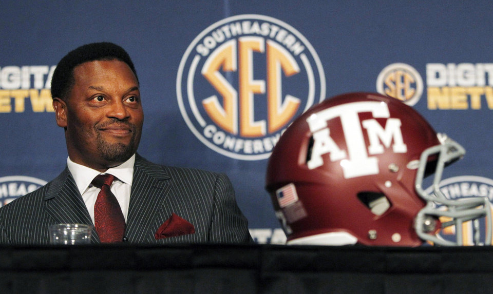 In this July 17, 2012, file photo, Texas A&M coach Kevin Sumlin smiles during a news conference at the NCAA college football Southeastern Conference media day in Hoover, Ala. (AP Photo/Butch Dill, File)