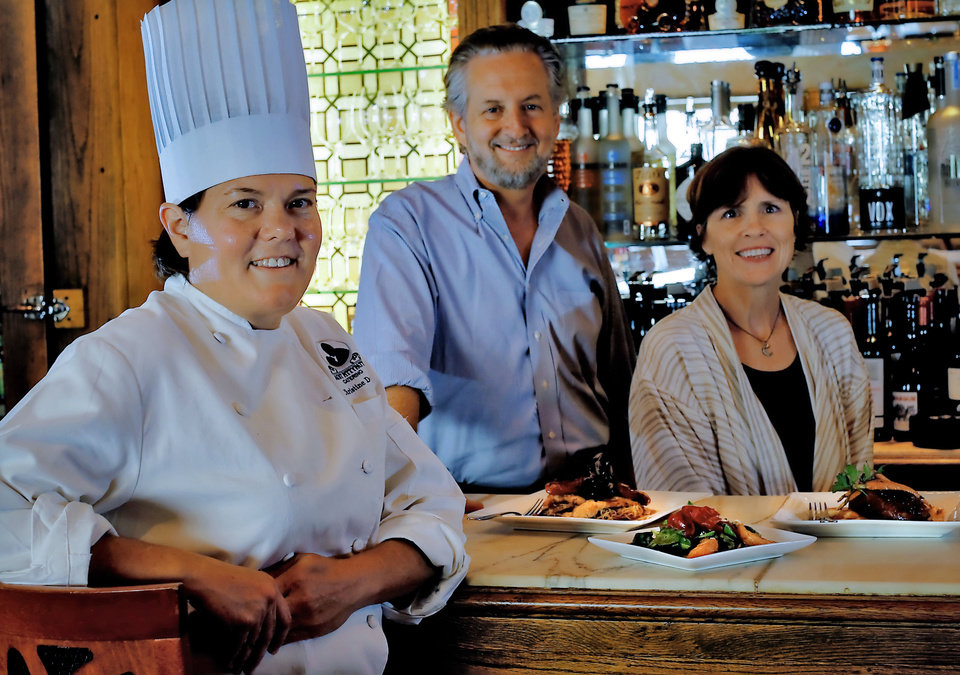 The Metro Wine Bar and Bistro's new executive chef  Christine Dowd poses for a photo with owners Chris and LaVeryl Lower. <strong>CHRIS LANDSBERGER - THE OKLAHOMAN</strong>